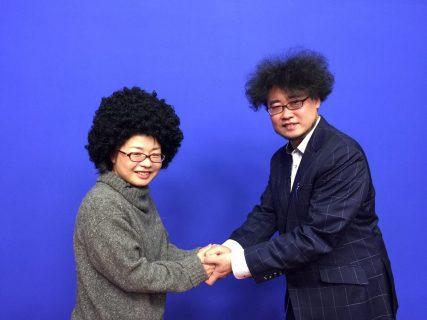 アフロ先生との握手写真